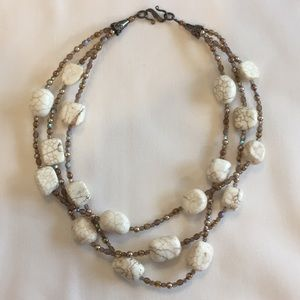 Cream stone and brown bead three-strand necklace